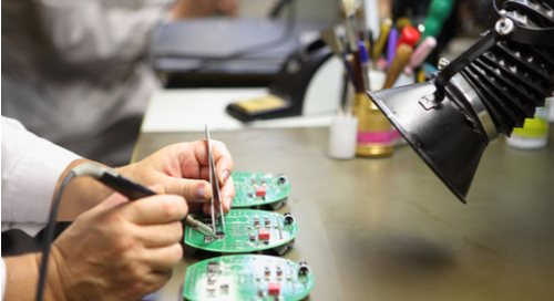Assembler soldering components on a PCB