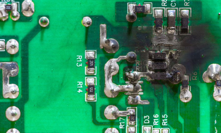 Thermal damage on a green PCB