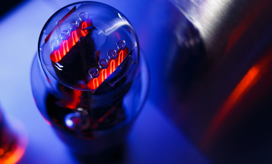 Glowing vacuum tube on a blue background