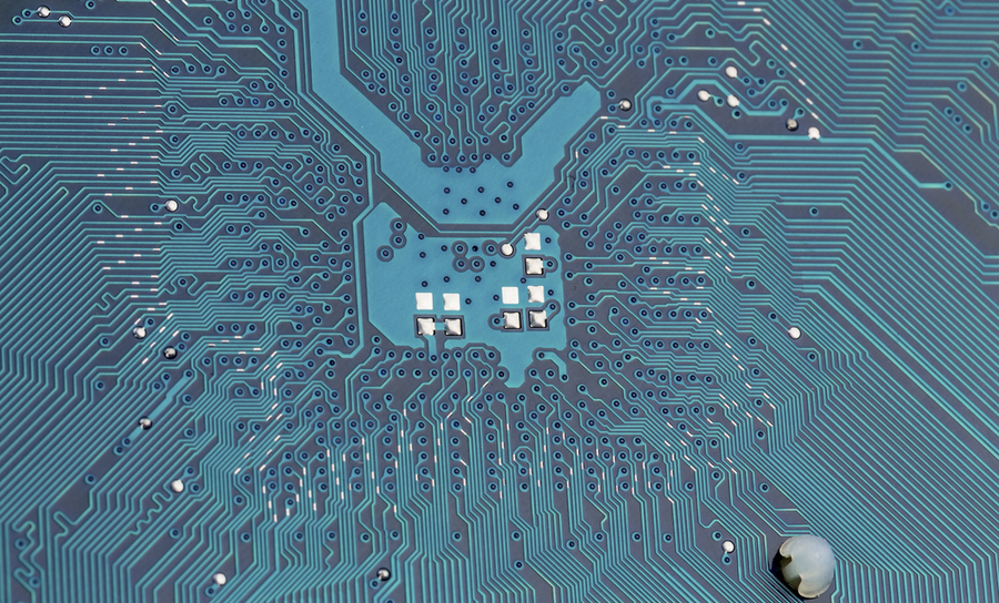 Microstrip traces on a blue PCB