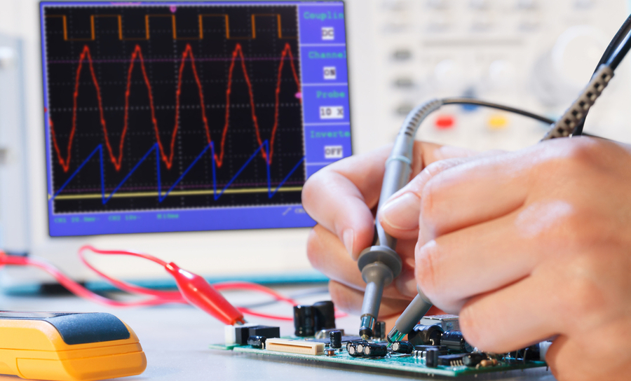 Manually testing a PCB with an oscilloscope