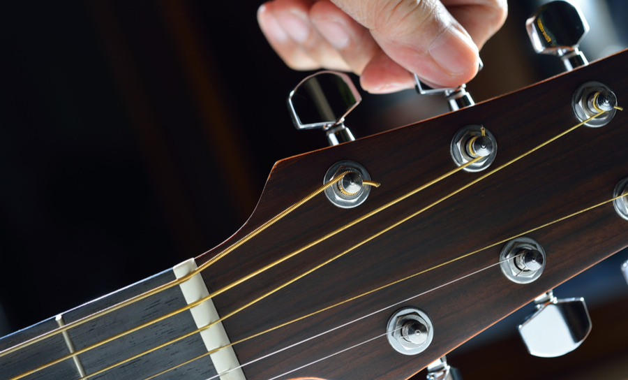 Hand tuning a guitar