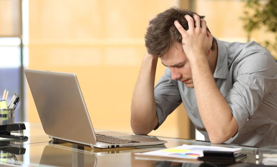 Worried man at his laptop
