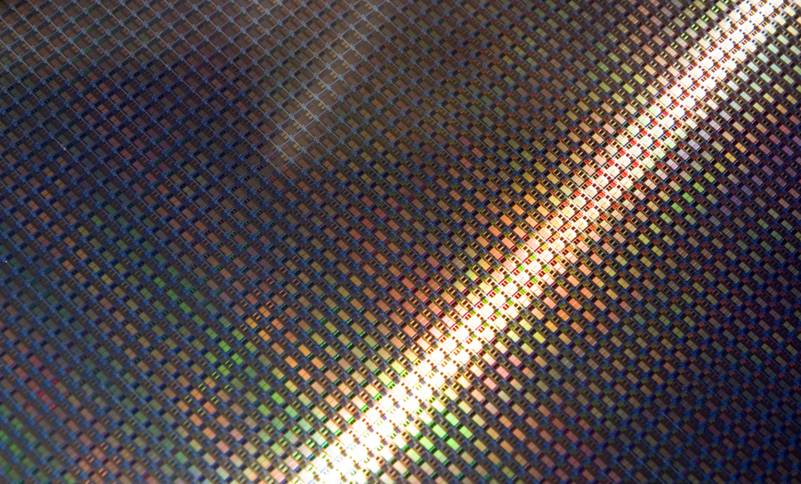 Wafer scale silicon photonics devices