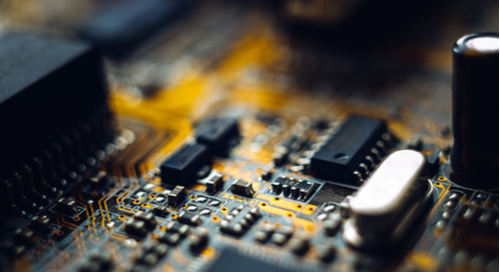 Electronic components on a black PCB