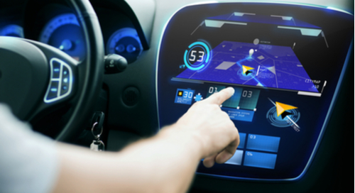 Driver using a car infotainment system