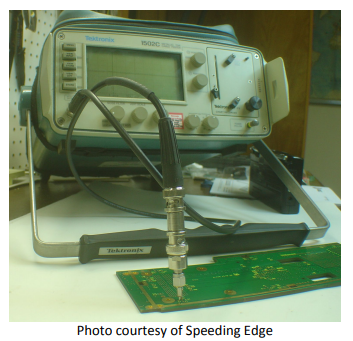 A Tekronix 1502C time domain reflectometer (TDR) Setup with the probe connected to a test point in a PCB for measuring impedance, photo courtesy of Speeding Edge.