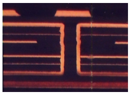 Cross sectional view of a buried via showing the copper passing in a hole that connects two inner layers of a PCB