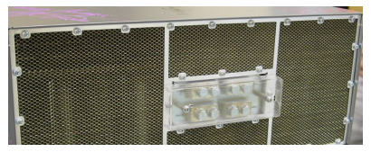 A honeycomb screen used as a Faraday cage that allows air out while keeping EMI in