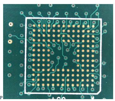 Photograph of the top layer of a PCB showing the footprint of a 0.5 mm pitch memory ball grid array (BGA) fanned out using a combination of through and blind vias.