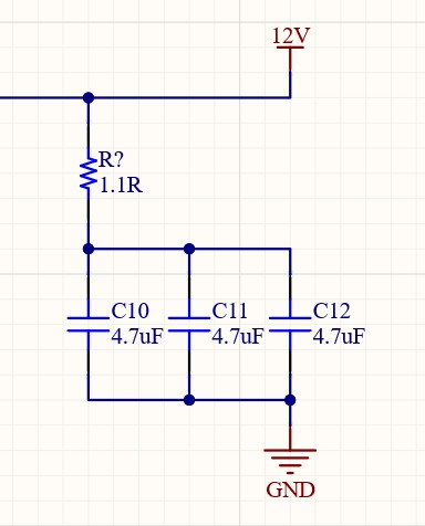 A resistor connected to three 4.7 microfarad capacitors.