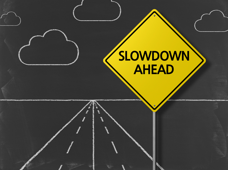 slowdown road sign