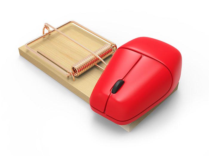 computer mouse inside mousetrap