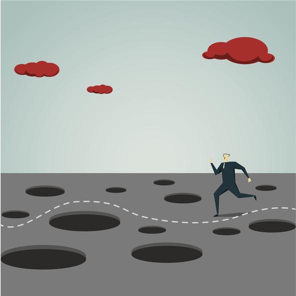 man navigating pitfalls
