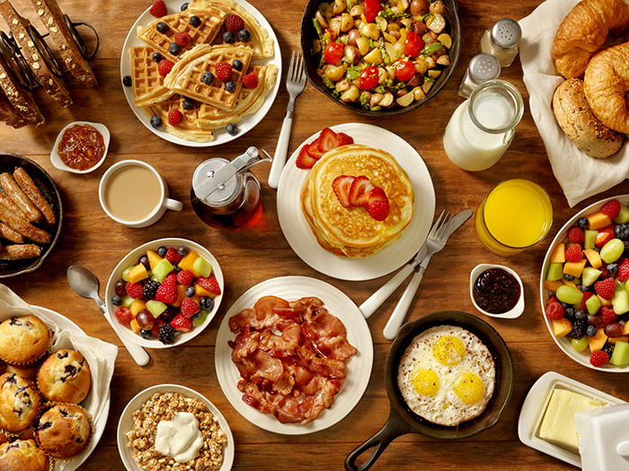 breakfast foods on wooden table