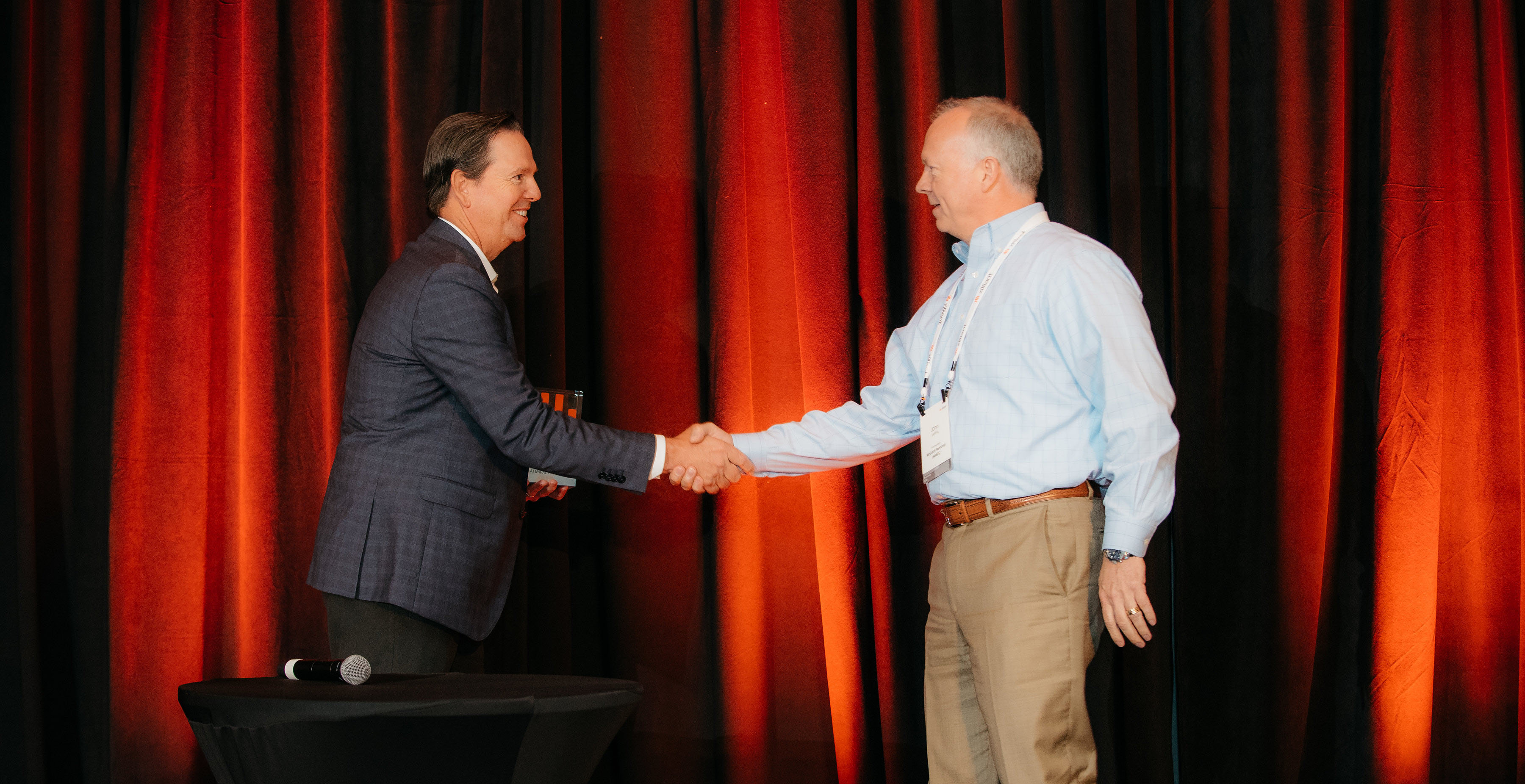 IMI Precision Engineering Sales and Marketing Director Paul Umpleby accepts the AI Process Integration Award from Zilliant CEO Greg Peters.