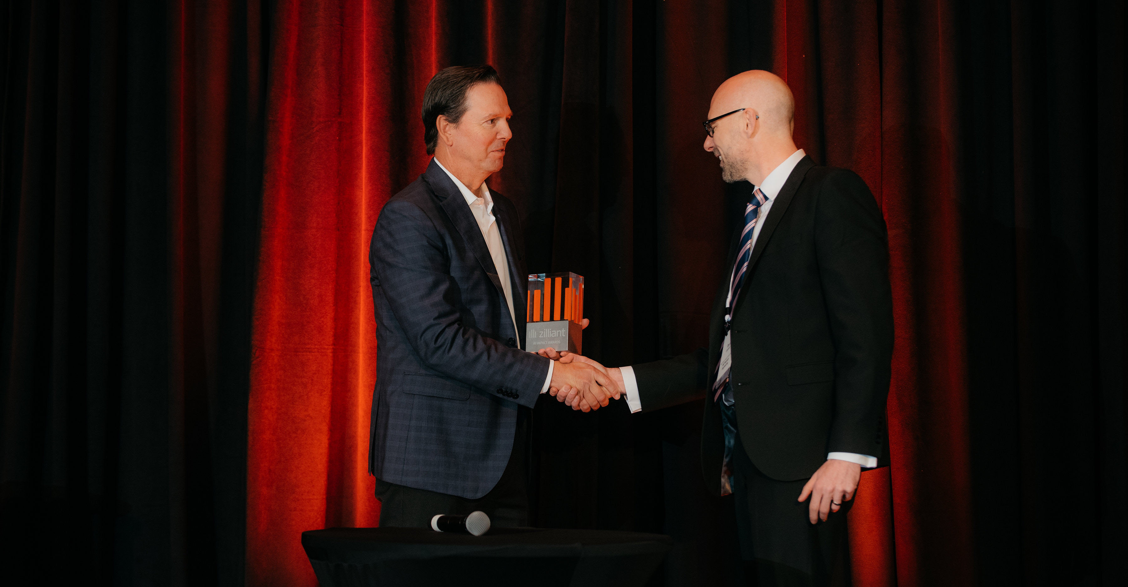 McGrath RentCorp Vice President and Division Manager John Lieffrig accepts the AI User Adoption Award from Zilliant CEO Greg Peters.