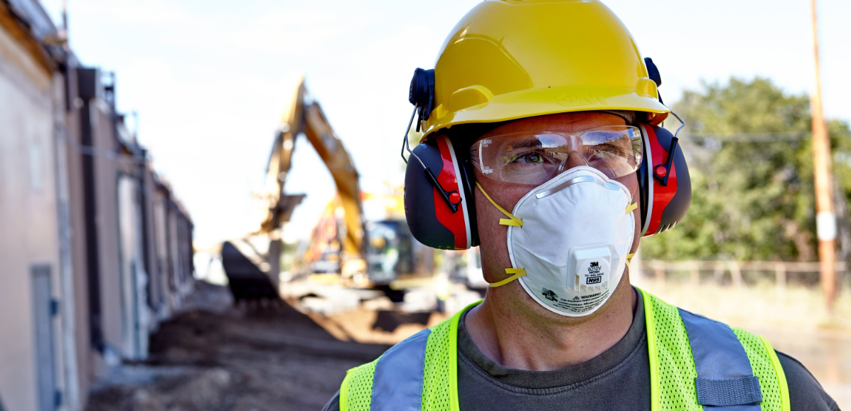 Man wearing disposable respirator.