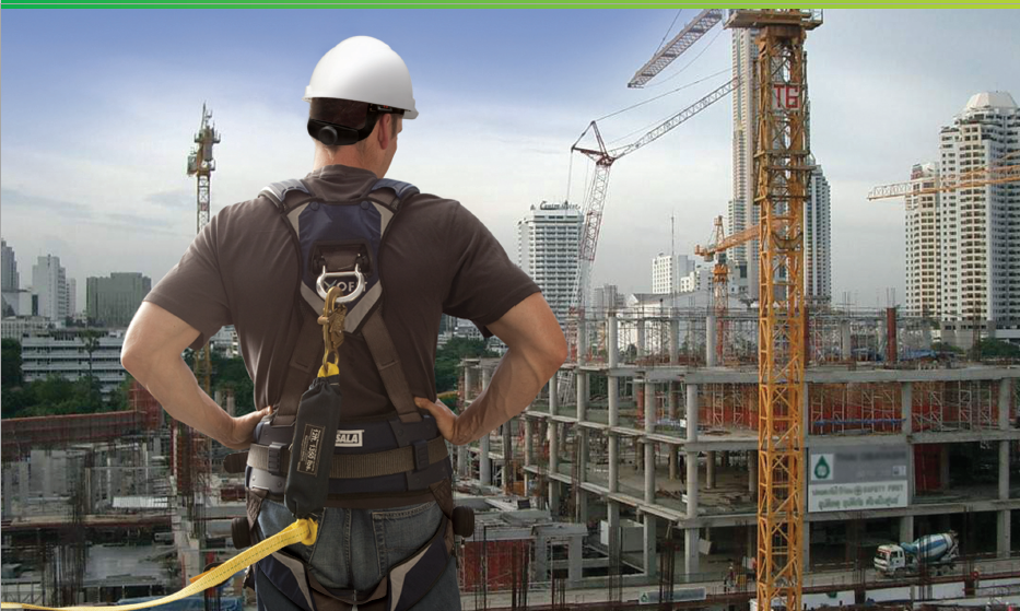 Man in harness on construction site.