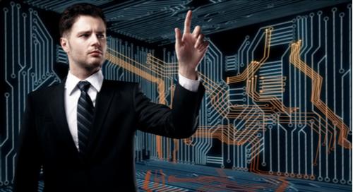 Geschäftsmann deutet auf PCB-Schaltkreise