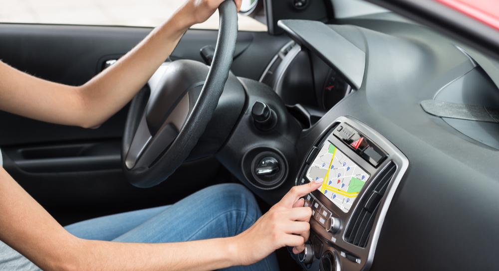 Woman Sitting Inside Car Using GPS Navigation