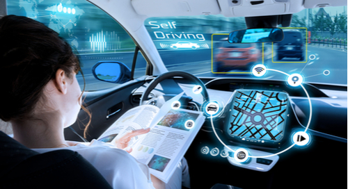 Woman reading book in self-driving car