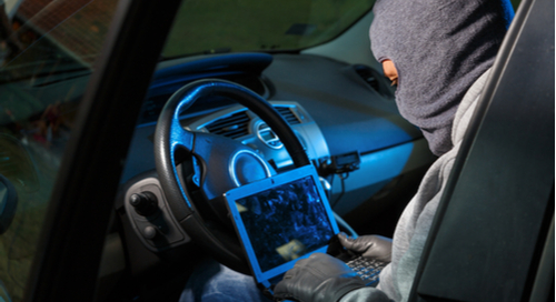 Hacker in a car at a computer