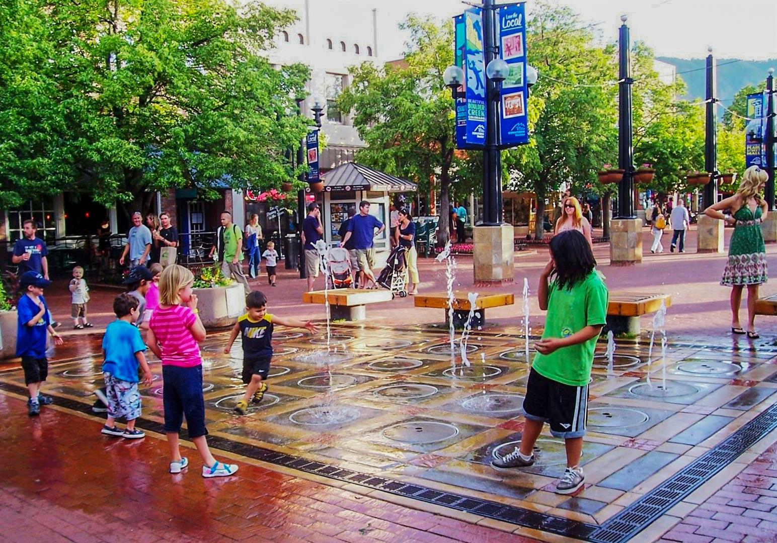 A splash park in the middle of an urban street