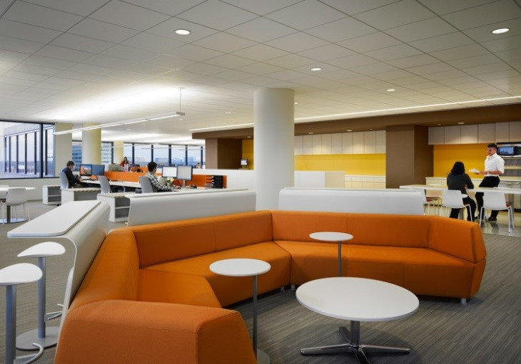 Interior open office area with couches and tables