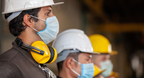 ServiceNow Safe Workplace App screenshot of Workplace Safety Management blogpost header image, industrial workers wearing masks