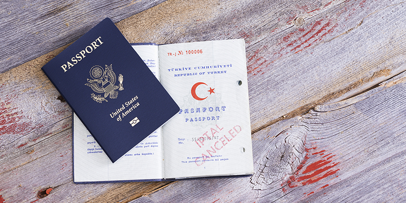 Two U.S. passports - one with the cover showing, one open to the pages inside.