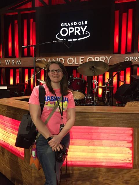 First-year music teacher Mollie Emerson poses in front of the stage at the Grand Ole Opry
