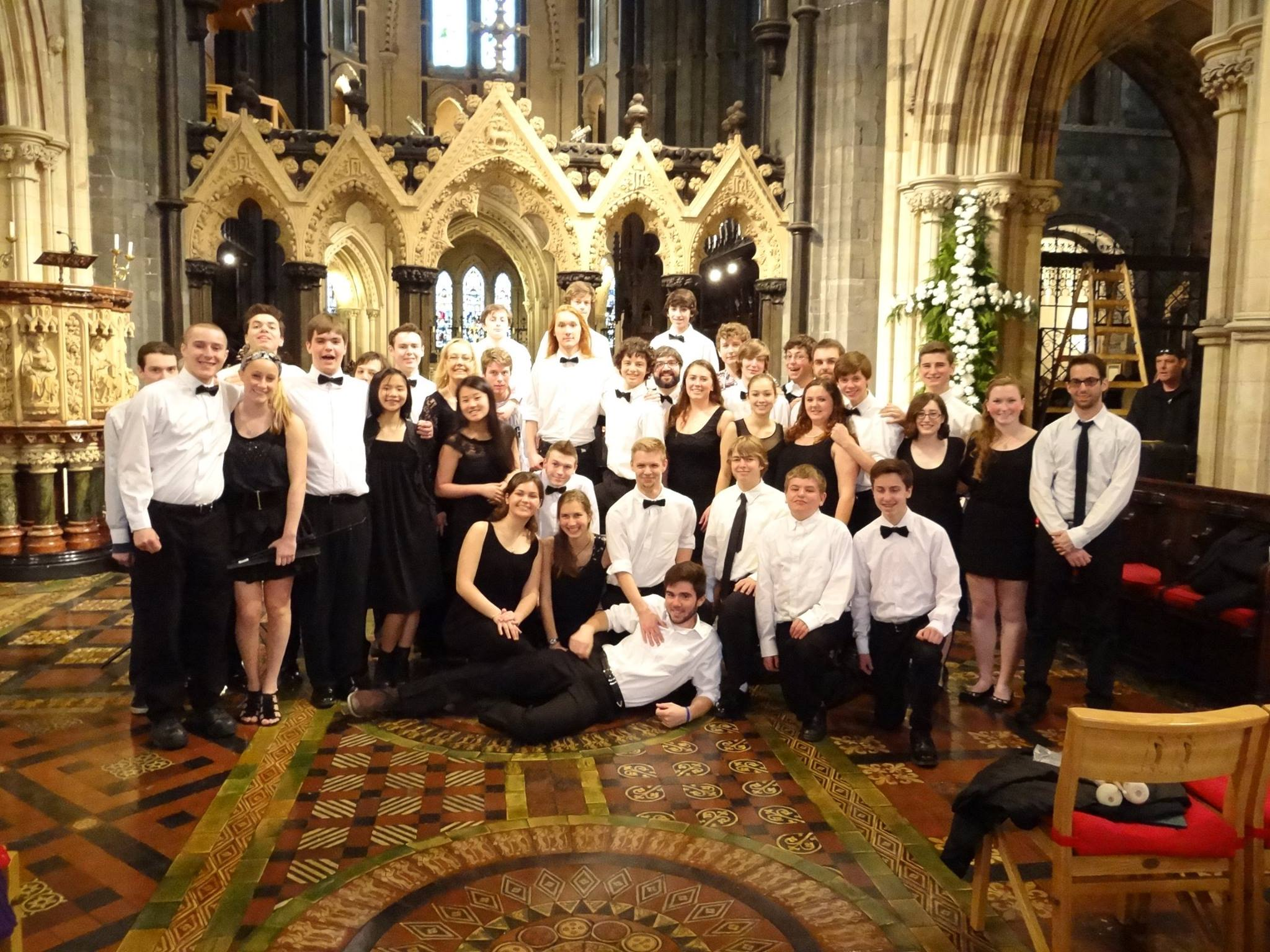 The 2014 Rockport High School Orchestra tour students wearing formal attire and posing for a group photo in Christ Church Cathedral, Dublin