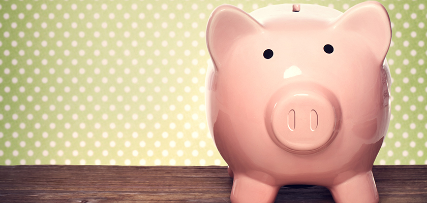 Cute piggy bank on polka dot background