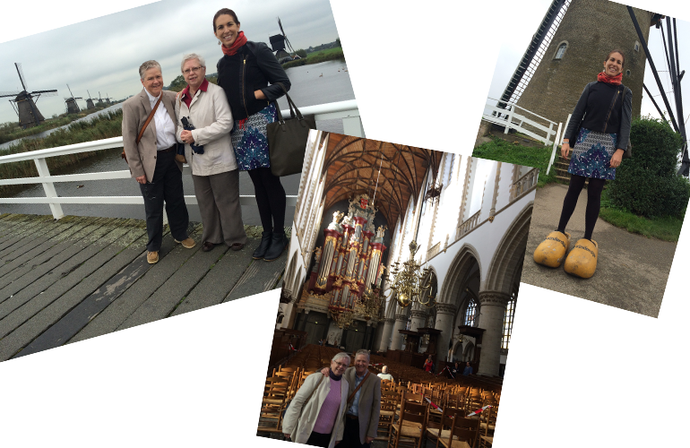 Collage of three photos. Left: Marion, Alice, and Sabrina pose on a wooden footbridge in front of a marsh with windmills in the background on an overcast day. | Middle: Marion and Alice pose for a photo inside the elaborate St. Bavo Cathedral, which houses the famous Muller organ with its bright red and gold accents at the altar | Right: Sabrina poses in front of a windmill wearing comically giant wooden clogs at the Zaanse Schans.