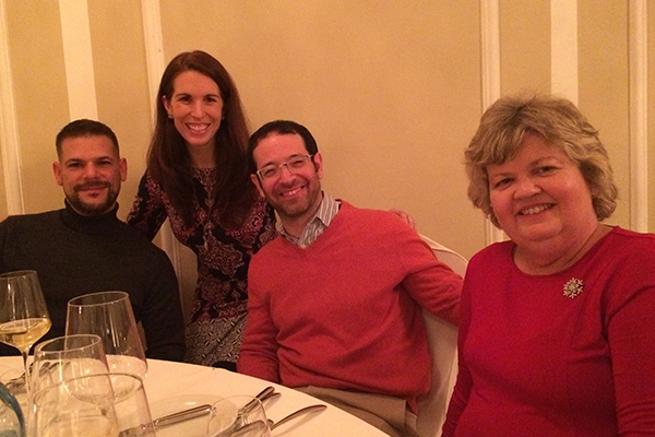 Program Manager Sabrina and Encore Group Leaders smiling for the camera at a Prelude dinner