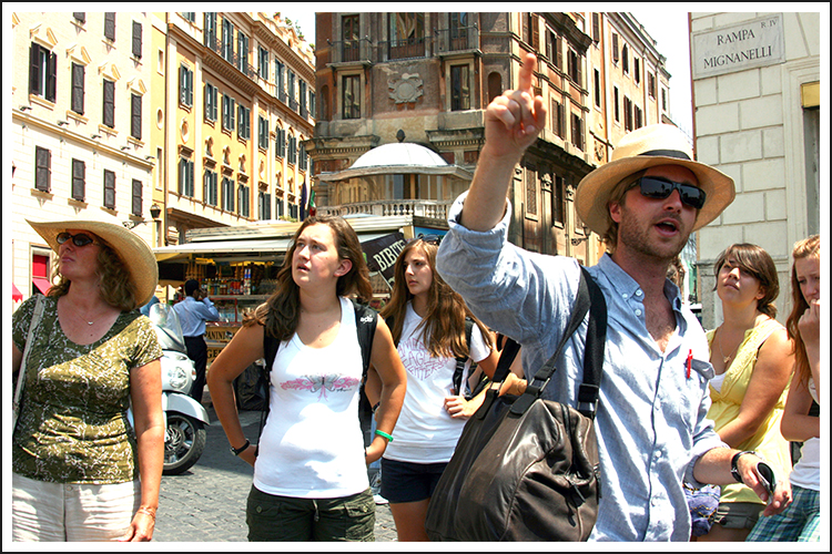 Encore Tour Manager showing passengers around the Spagna district (where the famous Spanish Steps are located) of Rome, Italy