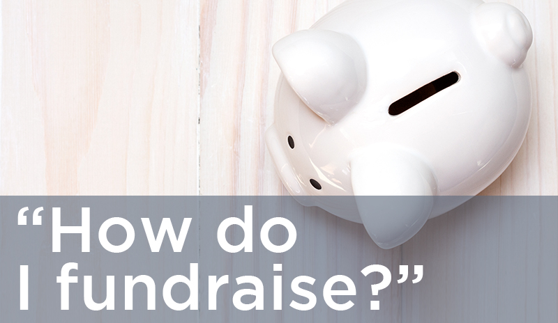 Text: 'How do I fundraise?' | Description: White ceramic piggy bank on birch tabletop; photo taken from above