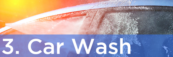 3. Car Wash   Description: Car being washed by a hose and sunlight shining off the hood of the car