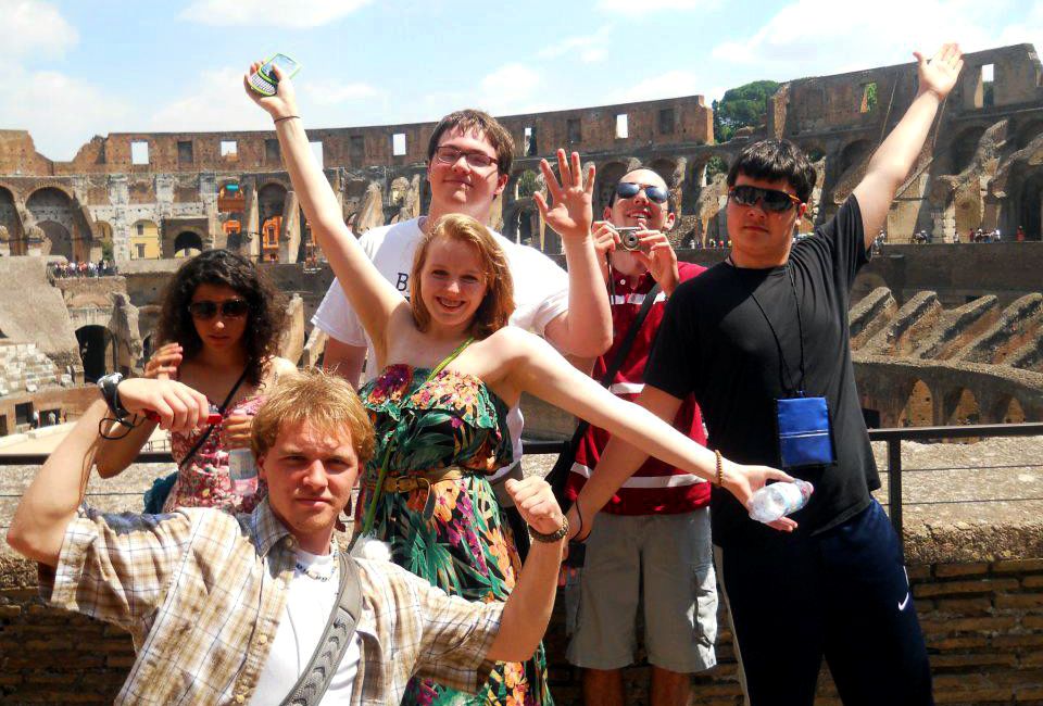 Group of students smiling at the Colosseum