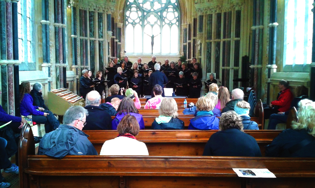 Performance at Kylemore Abbey - adult choir singing at altar in front of seated audience