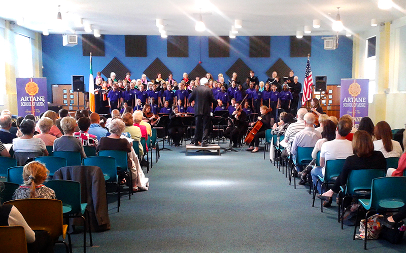 Artane School of Music - adult musical ensemble performing in front of a seated audience