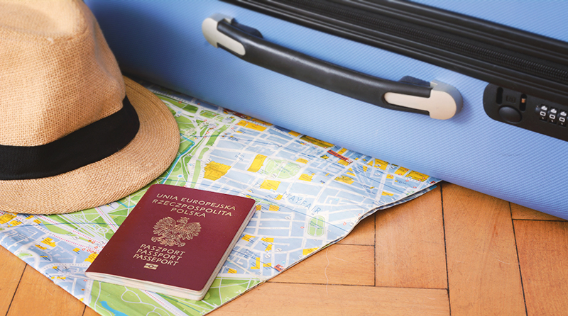 Image of suitcase, map, and passport