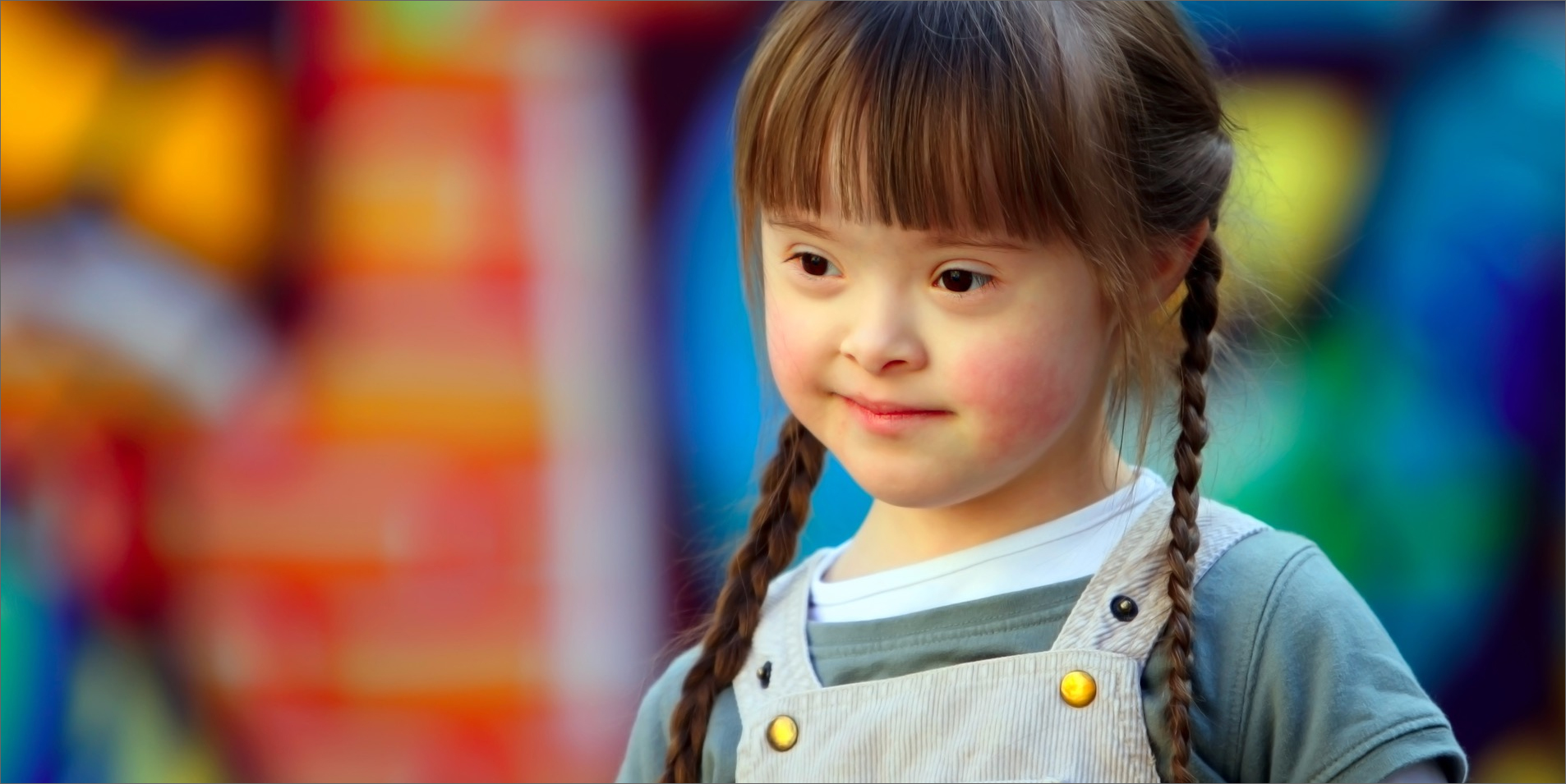 Smiling young girl with bokeh background