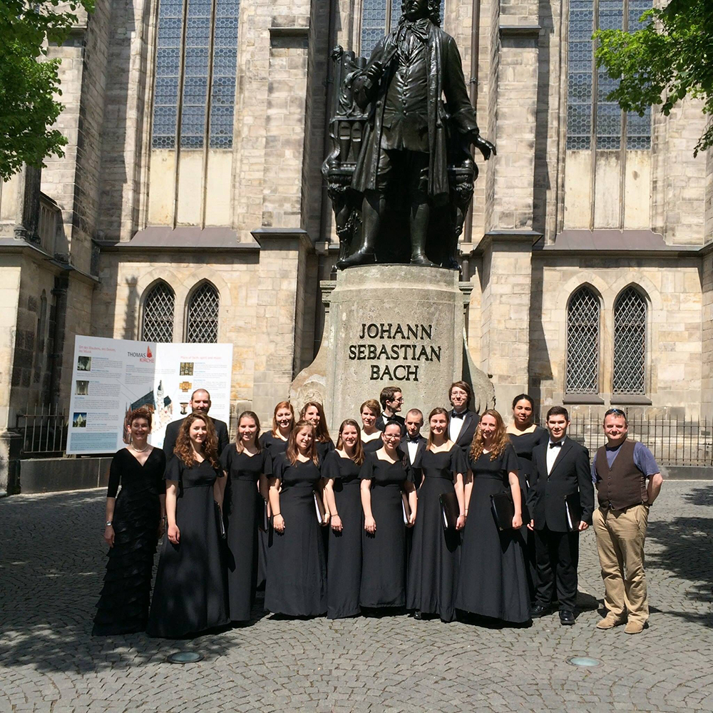 Choir standing in front of Johann Sebastian Bach statue in Leipzig, Germany