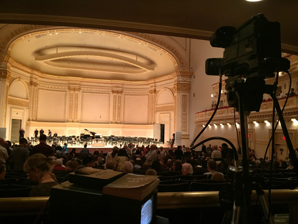 Video camera in Carnegie Hall recording performance