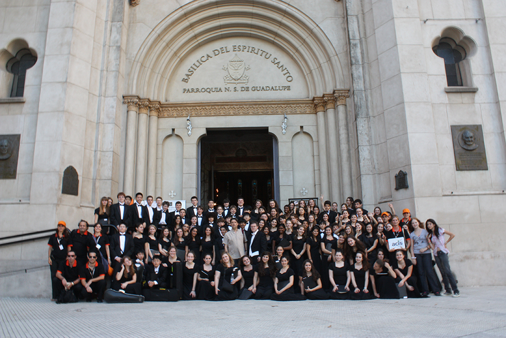 Orchestra posing in front of Basilica del Espiritu Santo in Argentina