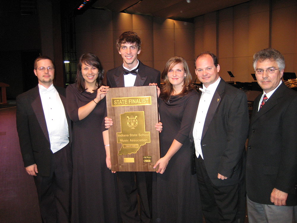 Goshen High School music ensemble members holding up Indiana State School Music Association State Finalist Plaque