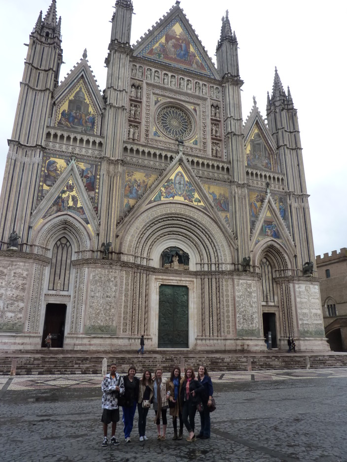 Encore group posing in front of the Orvieto Cathedral