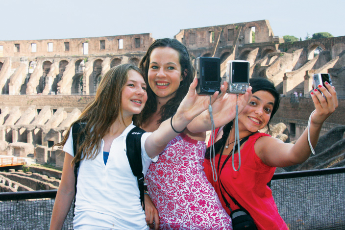Students taking a group selfie at the Colosseum